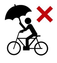傘をさして自転車に乗ってはいけません。雨の日にはレインコートを着用しましょう。